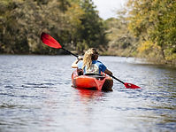 girl kayaking on river