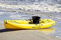 yellow single kayak on beach