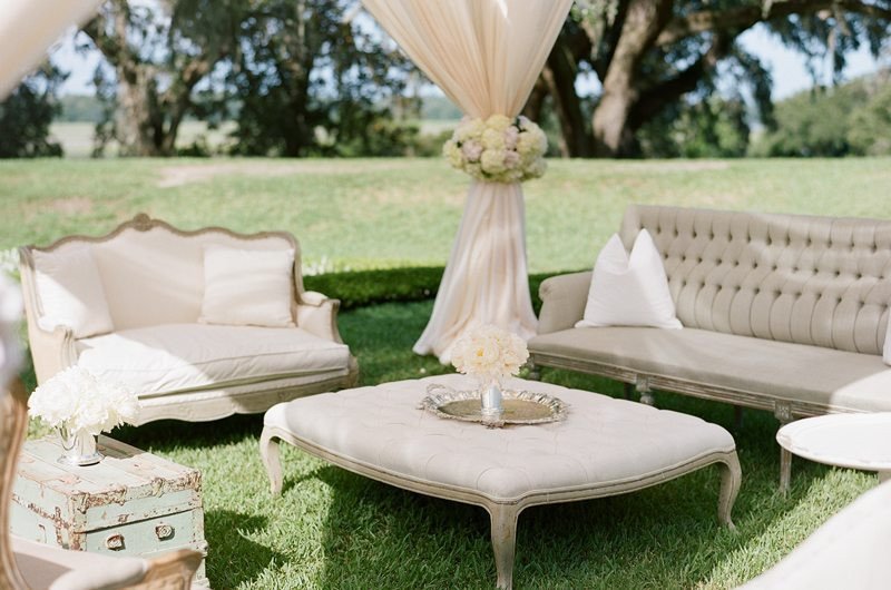 lounge chairs and table setting at formal wedding
