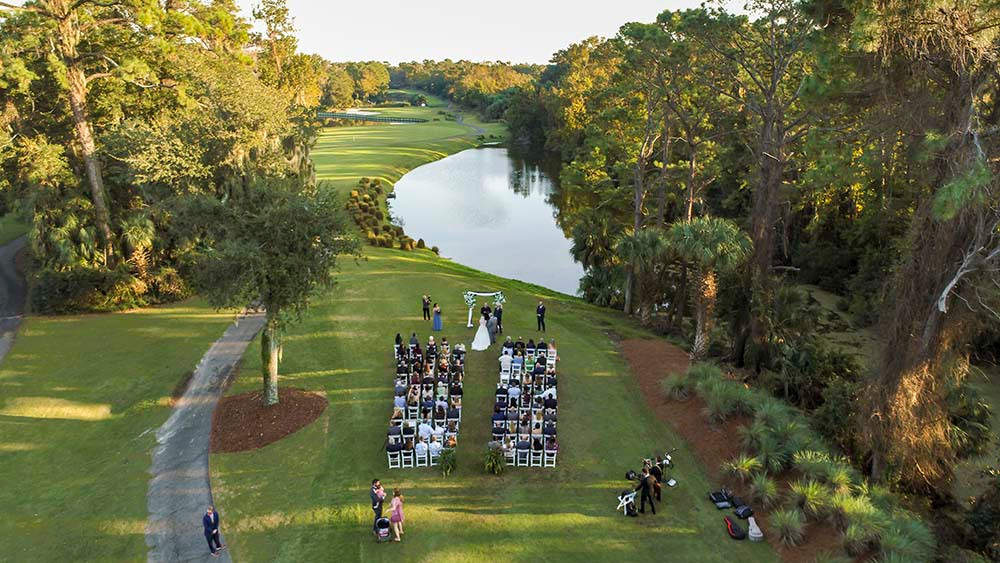 aerial view of wedding ceremony with lagoon water in background