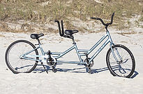 adult tandem bike on beach