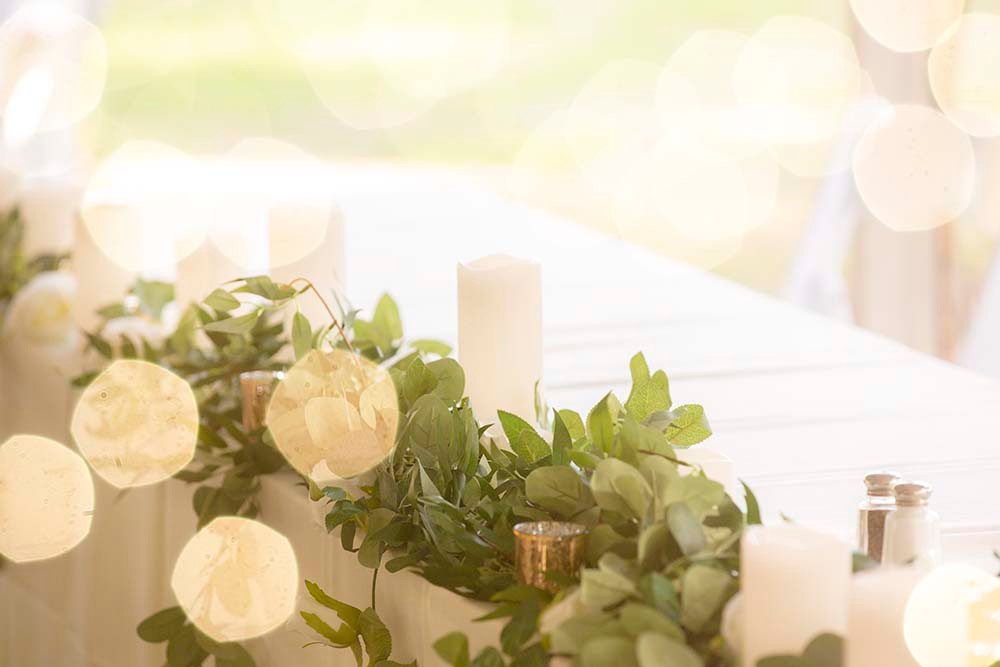 wedding tablescape with greenery and candles