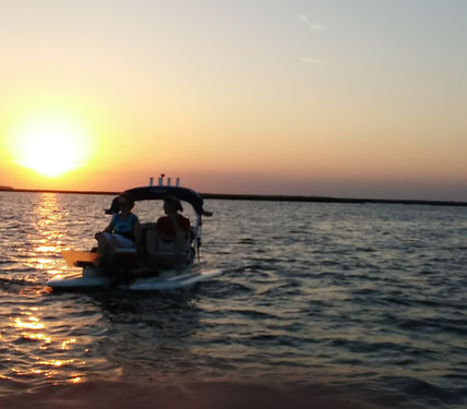Catamaran Boat At Sunset