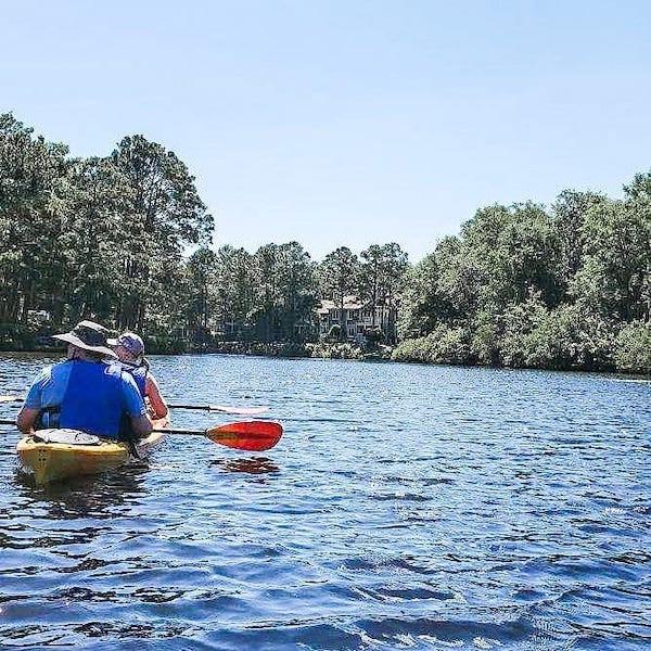 Kayaking couple in Palmetto Dunes Lagoon
