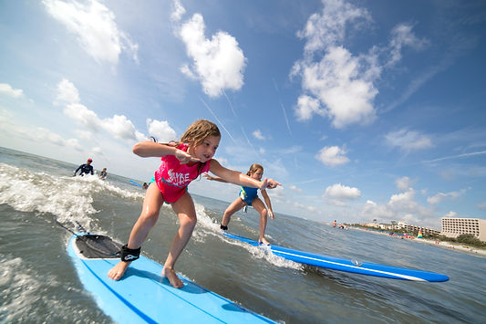 two girls learning to surf
