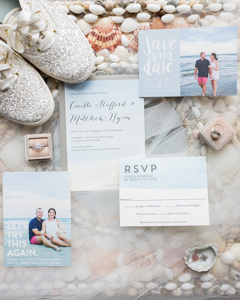 wedding details including invites, save the dates, rings, and bride shoes on seashells