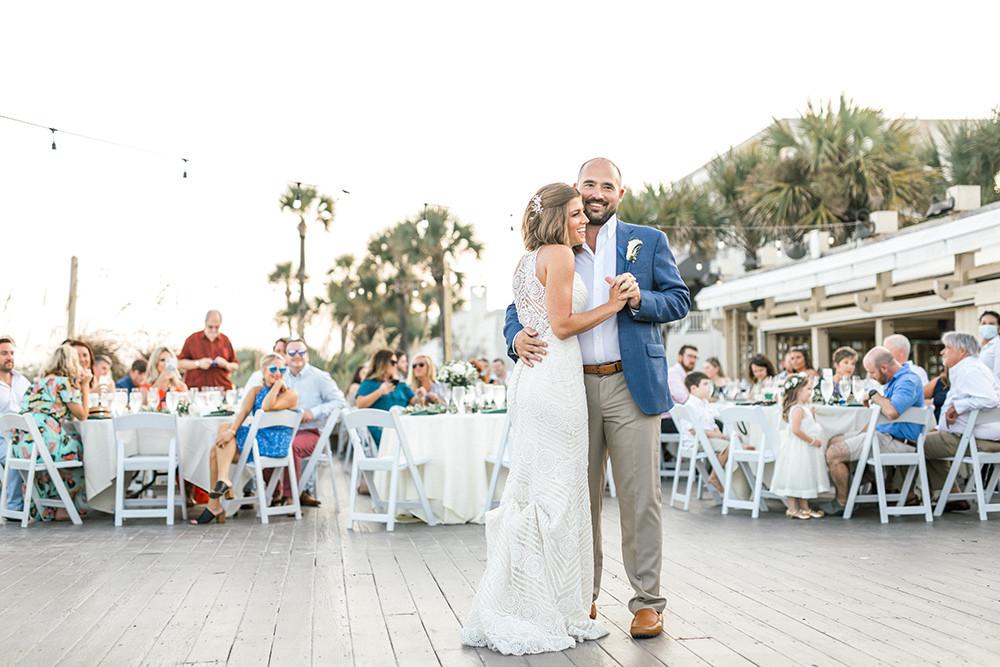 bride and groom dance in outdoor reception
