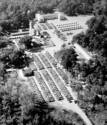 old aerial photo of lighthouse and marine barracks