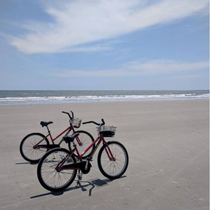 two rental bikes on beach