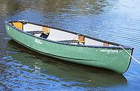 green three person canoe