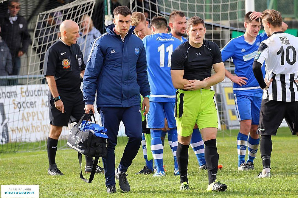 Boston Town Goalkeeper James Lambley is forced off with a dislocated collar bone