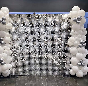Silver simmer wall with balloons 2.jpg