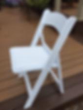 White resin padded chair.JPG