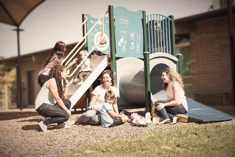 Mothers and babies and toodlers and preschoolers at a playground