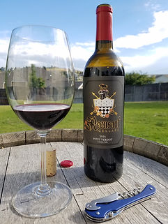 Recusant Cellas Wine Bottle and Glass on Barrelhead