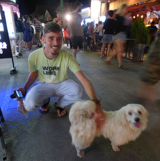 Mark with a street dog in Thailand