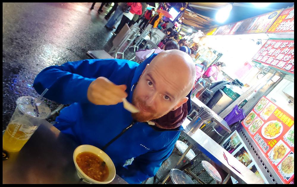 Eating street food at the Taiwanese night market