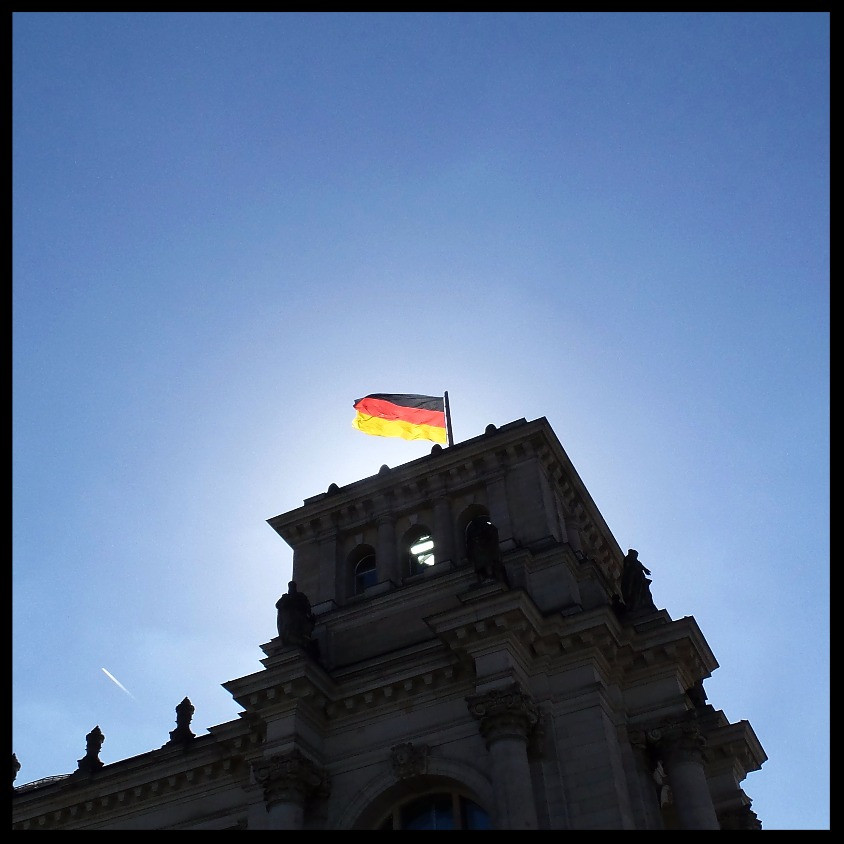 The German flag on the Parliament building