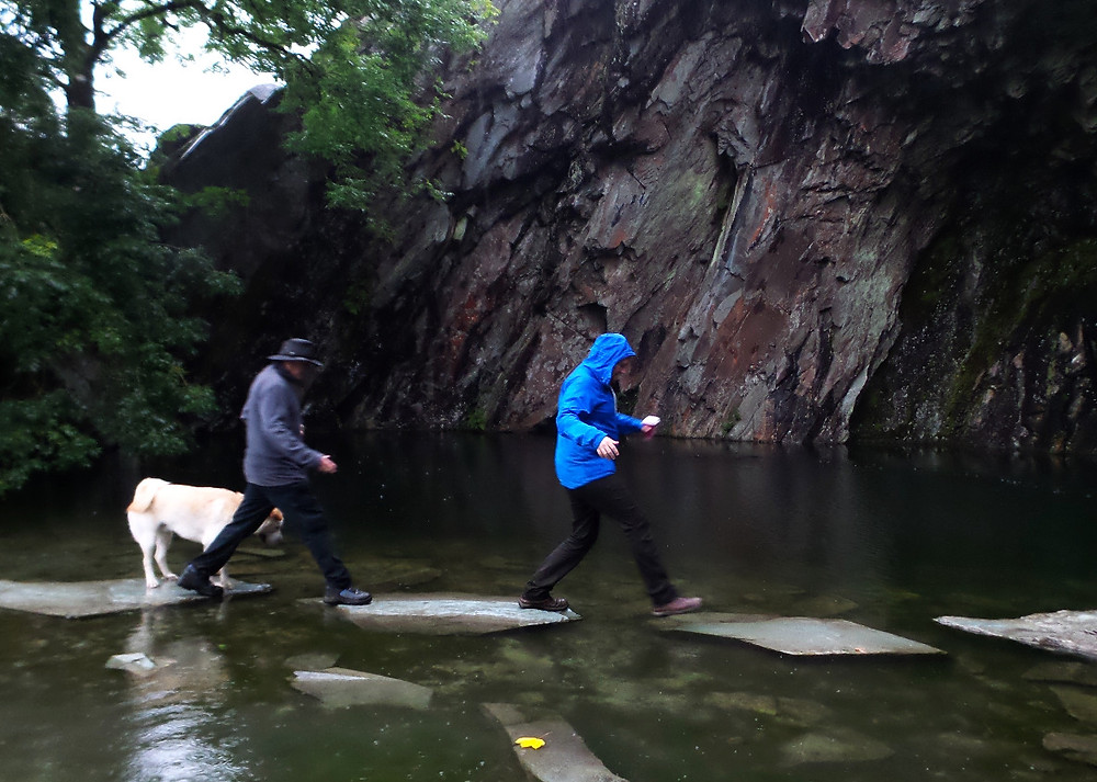 Mark's dad and Nate (and Baloo) negotiate the waters at Rydal Cave, Cumbria
