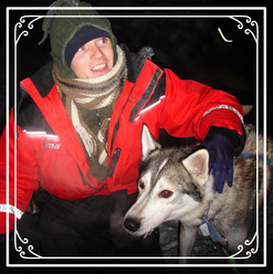 Mark and a huskie in Lapland