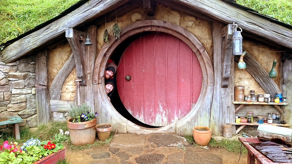 Two men peeping out of hobbit house, Hobbiton, Matamata New Zealand