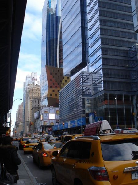 Street scene with yellow cabs in midtown Manhattan NYC
