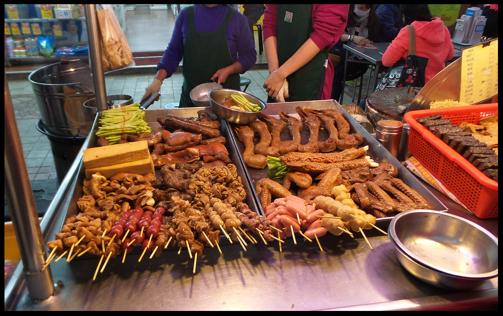A meat vendor in the night market, Taipei