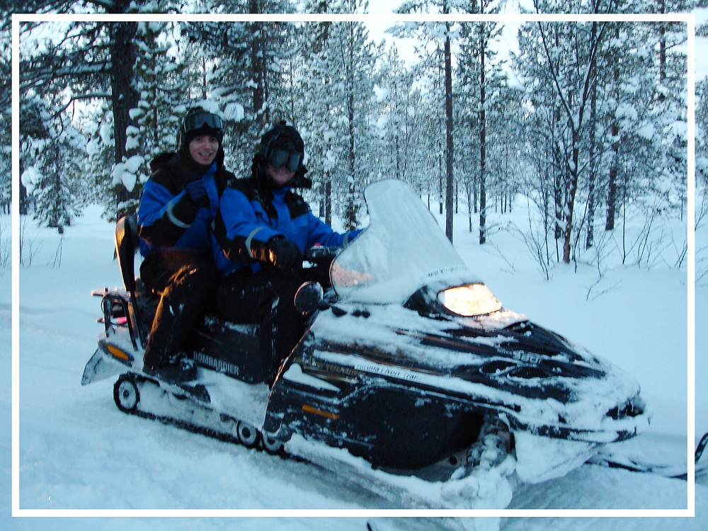 Riding a snowmobile in the Arctic forest