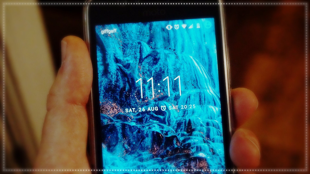 Close up of phone screen showing 11:11