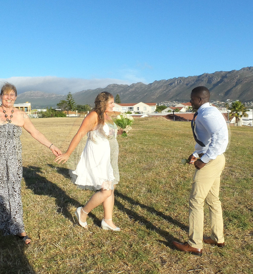 Jennifer and Moses on their wedding day, with Jenny's mum Christine giving her away