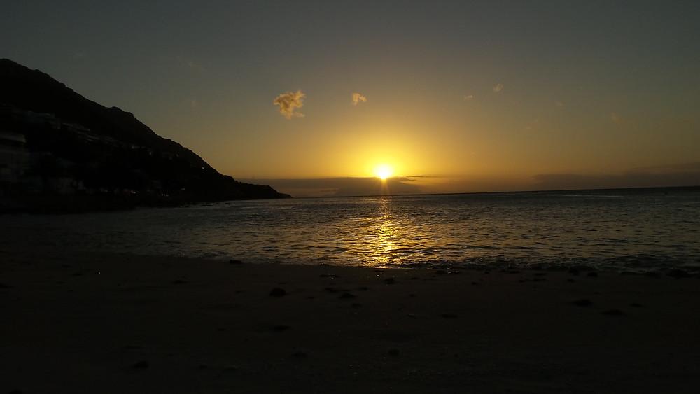 The sun sets over Gordon's Bay