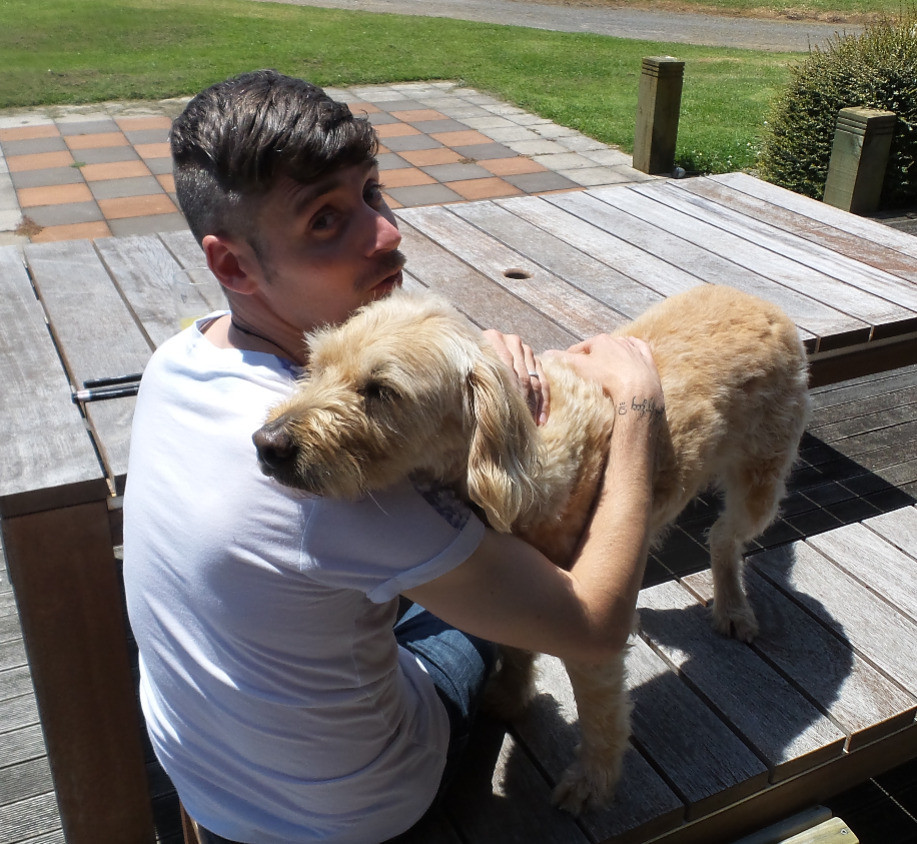 Having a hug from Harvey the labradoodle in New Plymouth, NZ