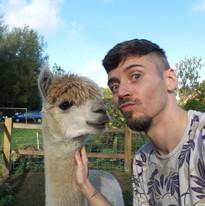 Mark with Merlin the alpaca