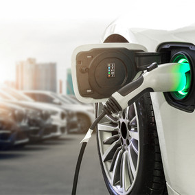 EV Charger Plugged Into Electric Vehicle