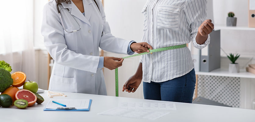 cropped-of-doctor-measuring-patient-body