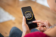 woman-using-cashback-app-on-phone-XRUGAL