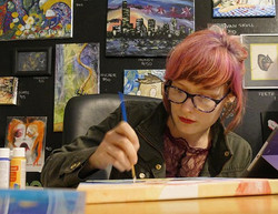 Annette Nowacki working on a canvas