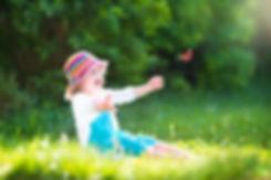 Happy laughing little girl wearing a blu