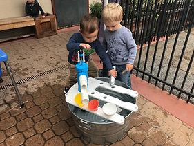 Ben & Elliott water pumping.JPG
