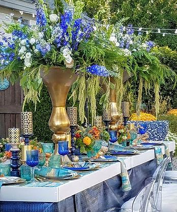 Coastal modern weddding maine. gold and blue and aqua tablescape.
