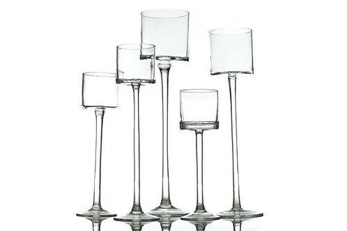 Clear glass pedestal candle sticks