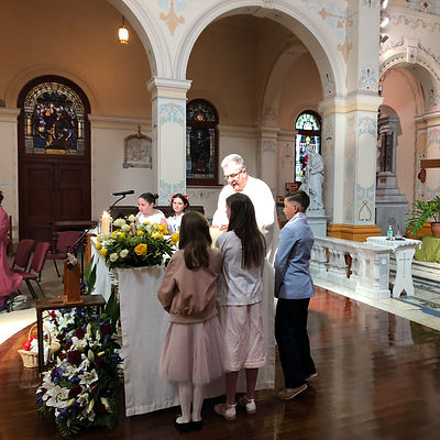Children at the altar with Fr John