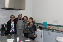 Jane, Adrian, Mairead and Toni running the kitchen