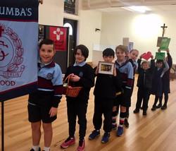 Children at Feast of St Columba mass