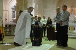 pouring the water for adult Baptism