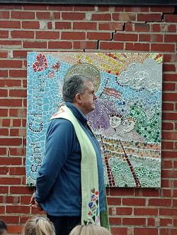 Fr John in front of mosaic