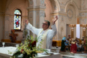 Fr John blessing at mass.jpg