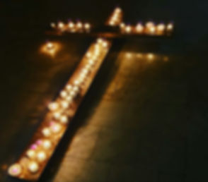 Candles lined up on the cross