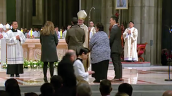 Alecia, Carlo, Christine and Roger receiving a blessing from the Archbishop