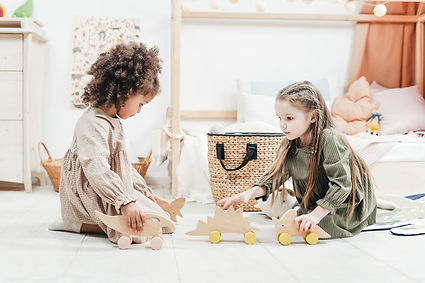 photo-of-girls-playing-with-wooden-toys-